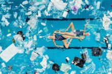 swimmers-perform-in-a-pool-filled-with-plastic