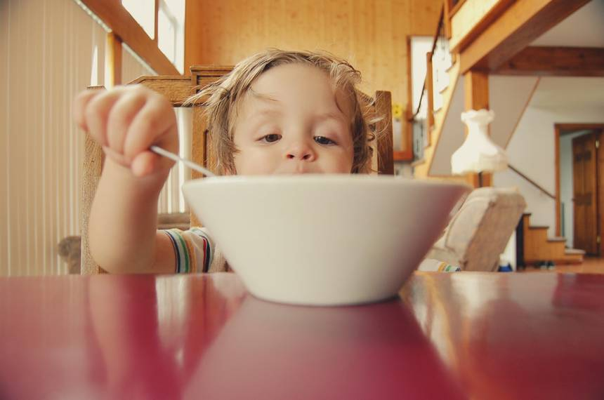 little kid with a bowl of food.jpeg.860x0 q70 crop-scale