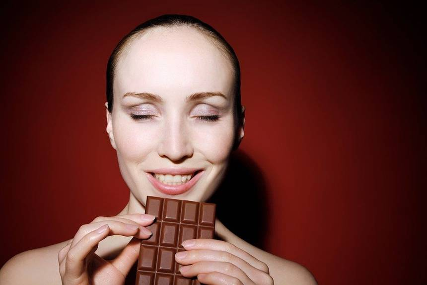 woman with chocolate bar.jpg.860x0 q70 crop-scale